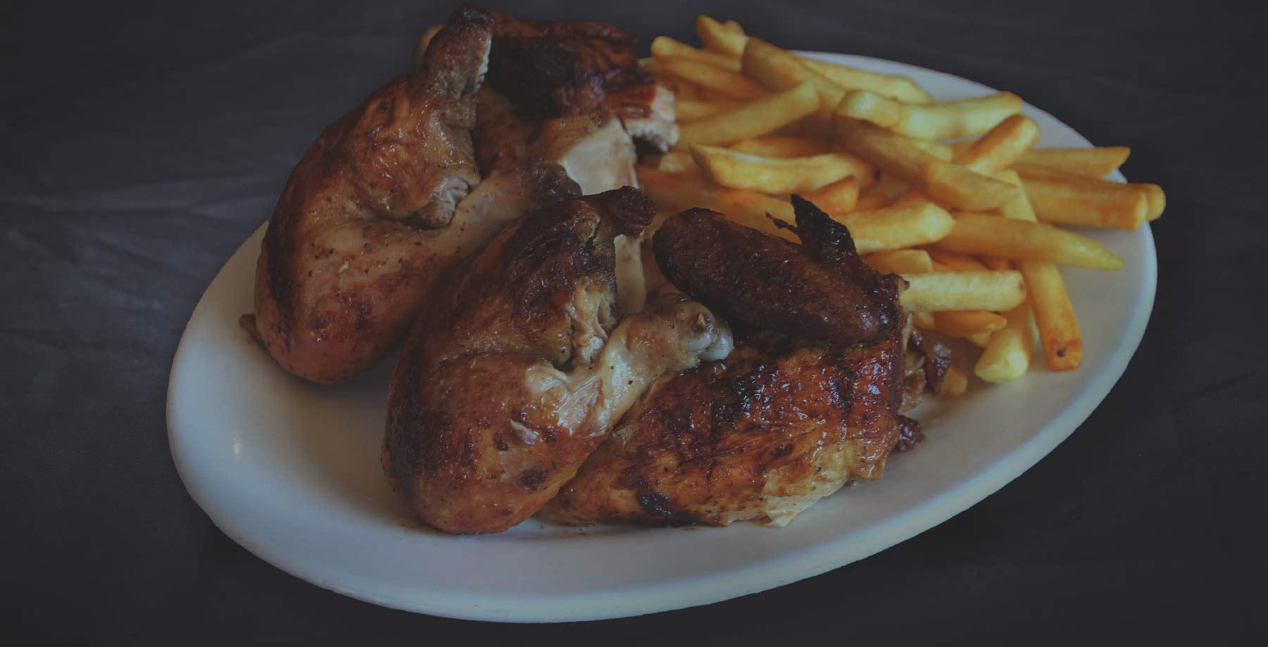 El Pollo Inka Peruvian rotisserie chicken and French Fries